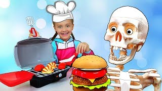 Nastya y papá fingen jugar a cocinar con BBQ Grill Toy