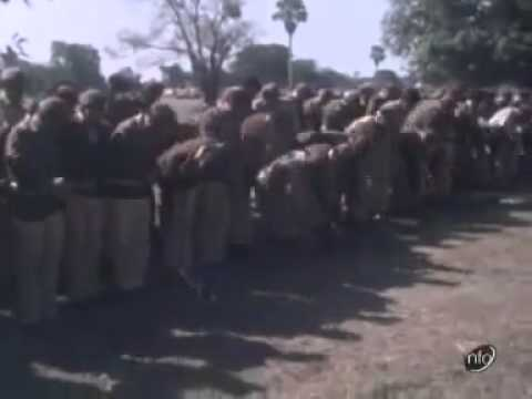 Pakistani troops lay down their weapons