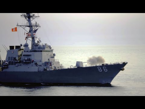 Navy Destroyer USS SHOUP fires the Mark 45 5-inch naval gun