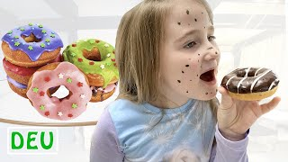 Annie bekommt und isst Donuts