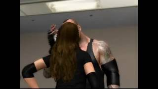 Undertaker kisses Stephanie McMahon in the Locker Area