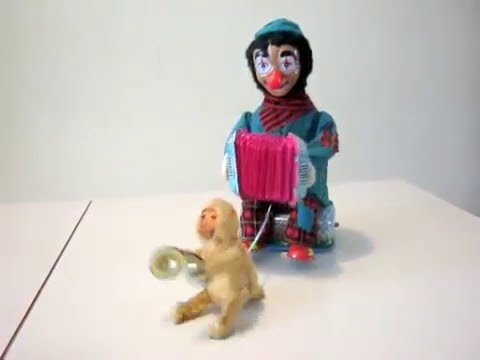 ACCORDION PLAYING HOBO WITH MUSICAL CHIMP