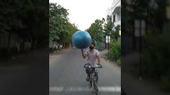 longest time spinning yoga ball in single finger while cycling- world record