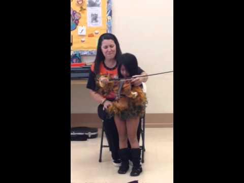 Oct 2014 Brookelyn playing the violin at Musical Munchkins class
