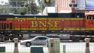 Bnsf 6337 heads west at dodge city kansas with some amazing power and an oakway.