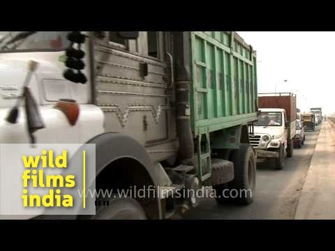 Truck and jeep traffic crawls along in Faridabad