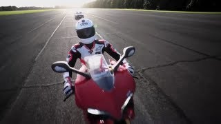 200mph Drag Race: Porsche GT2 RS v. Ducati 1199 Panigale - /CHRIS HARRIS ON CARS(Last time, on the drag strip, the Porsche was destroyed. This time we went to a 2 mile runway to see what happens when you let a GT2 RS stretch beyond ..., 2012-11-07T20:00:29.000Z)