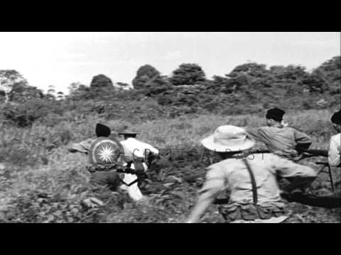 French troops advance in Indochina. The take cover under fire. French capture con...HD Stock Footage