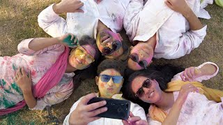 Young people recording funny selfie video with colored Gulal faces - Holi festival