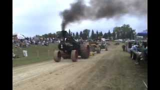 Case Steam tractor at rollag WMSTR 2010 tractor pull....powers out with wheels in the air!!!
