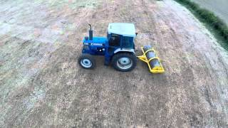 FORD 7710 AND JOHN DEERE 6610 AND FLAT ROLLS