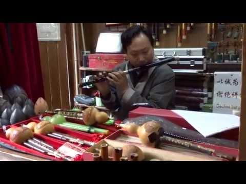 Guy Playing Chinese Classical Music on Flute Chengdu China