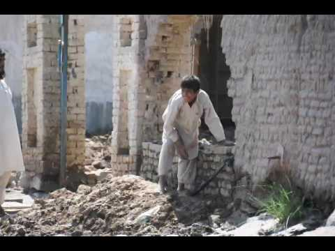 boy makes mud brick wall - Nangarhar Prov., Afghanistan