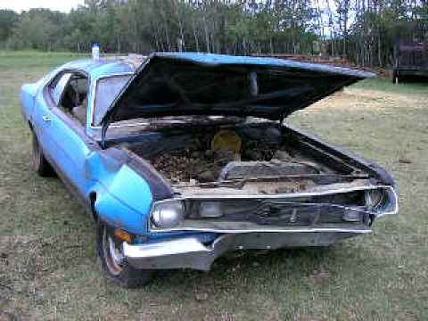 cars in barns -1975 duster first start since 1989 !!!