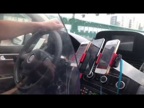 Taxi Driver With 5 Phones DiDi Shanghai China Mobile App Business