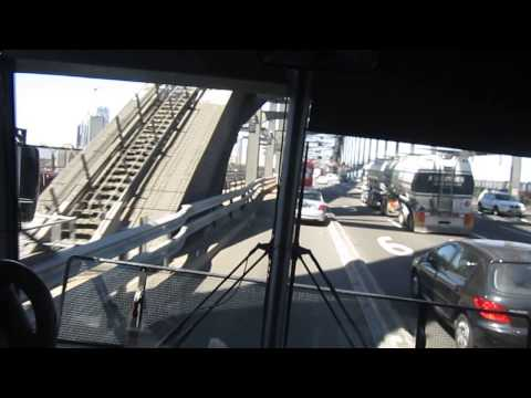 Crossing the sydney harbour bridge while 2 Sydney trains K and S set come by