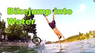 Jumps with Bike into Water - Refreshing on hot days