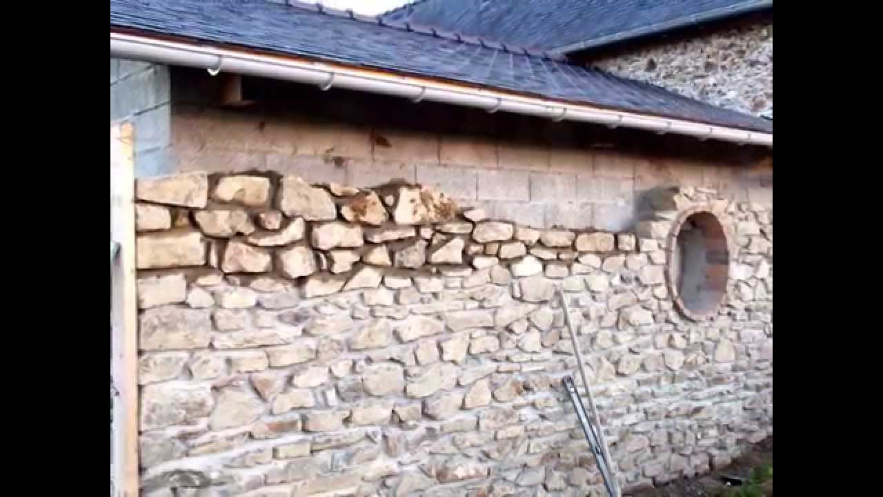 Monter un mur de pierre youtube for Peut on coller du carrelage avec du ciment