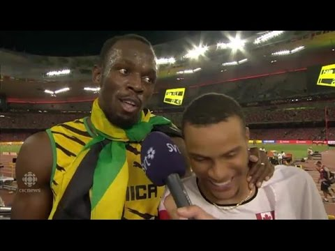 Andre De Grasse surprised by Usain Bolt during interview