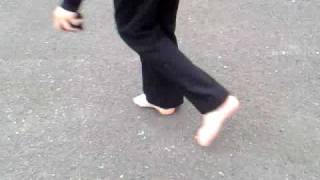 robbie walking barefoot home from school