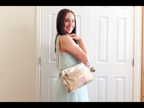 On The Body: Pink Lining Mini Yummy Mummy Diaper Bag in In The Mews Pink Bikes