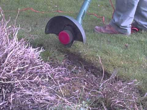 How To Use A String Trimmer Properly Edging Flower Bed