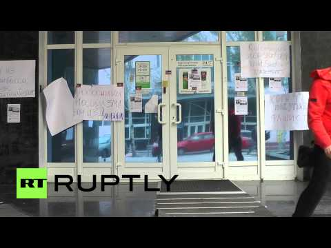Ukraine: Anti-Kolomoyskyi posters cover shuttered Privatbank