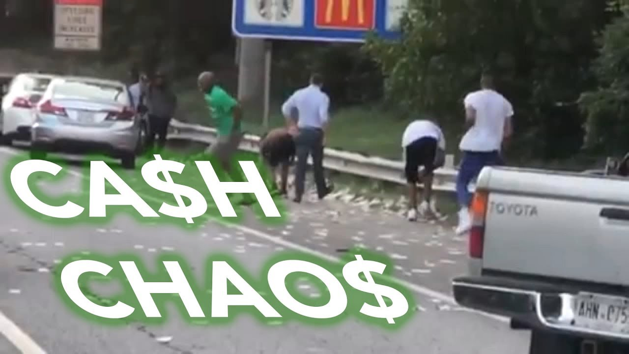 Cash Chaos: Drivers stop to grab money dropped by armored truck