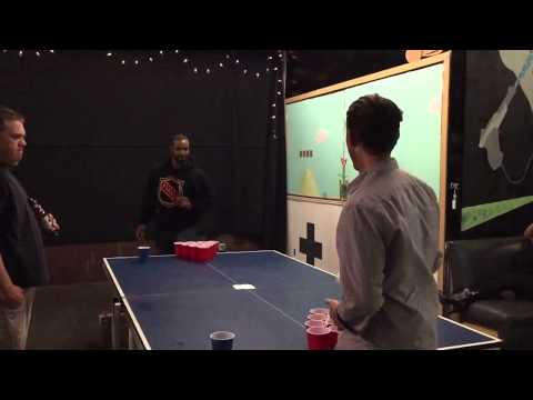 Isaiah Mustafa and I getting serious about beer pong.