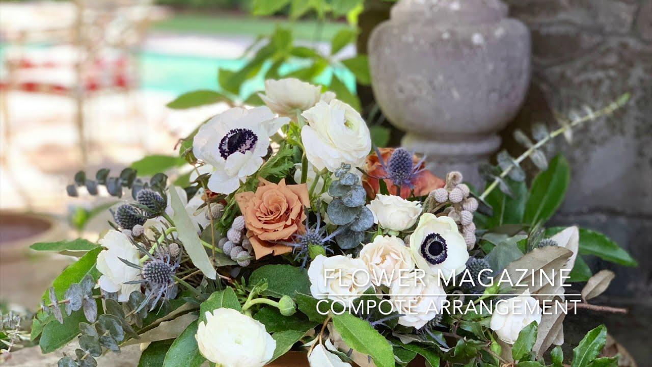 arrange flowers in a compote vase