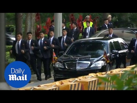 Kim Jong Un's bodyguards run beside his limo in Singapore