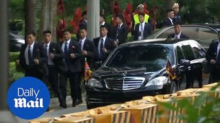 Kim Jong Un's bodyguards run beside his limo in Singapore - Daily Mail