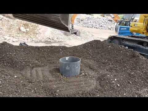 JCC Engcon Group excavating & shaping with tiltrotator at Hillhead 2010