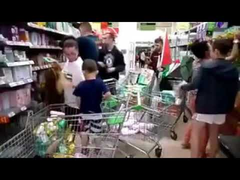 Irish Shoppers remove Israeli products from a shop, to show their support for Palestinian people.
