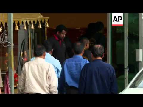 Body of Indian rape victim arrives at funeral house prior to being flown home