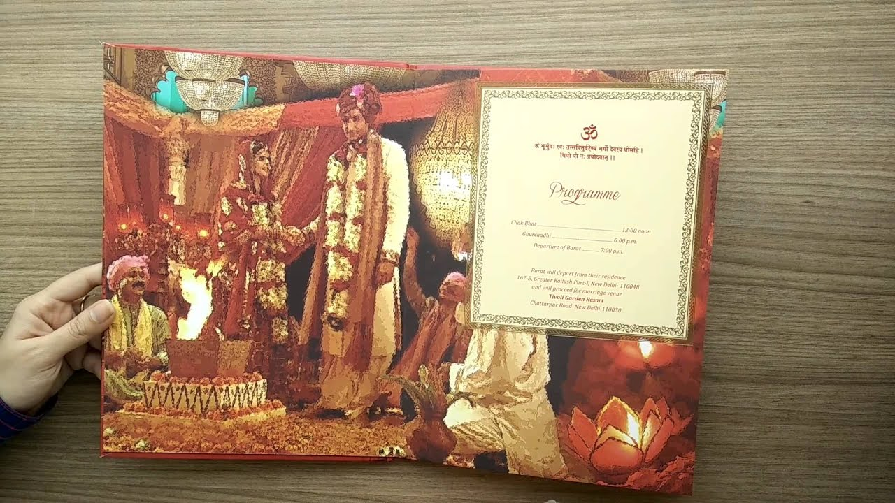 royal indian wedding card in pink and royal procession image