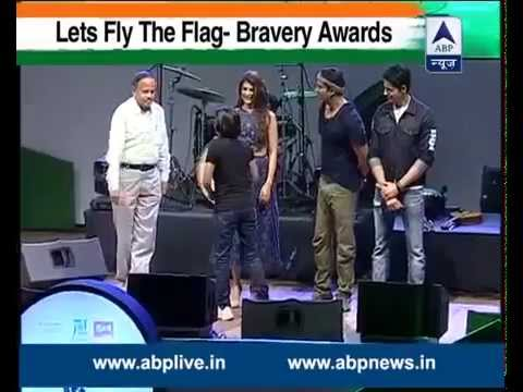 Dr Govind giving away a Bravery award ABP NEWS