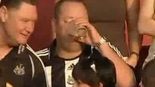 Mike Ashley downing a pint