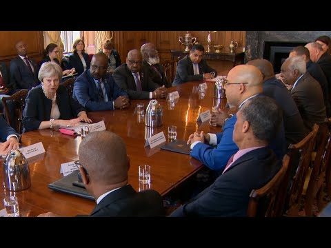 Theresa May apologises for treatment of Windrush generation