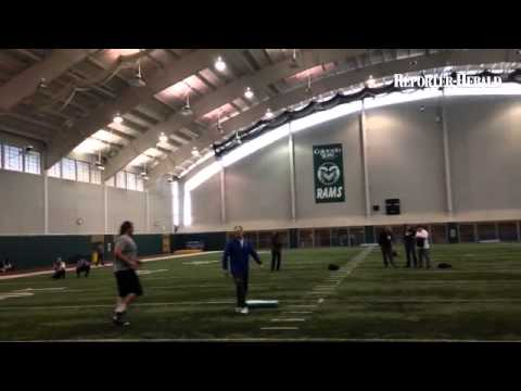 Indy line coach Hal Hunter running tackle Ty Sambrailo through drills at CSU pro day