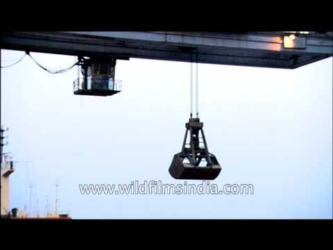 Ship unloading and retrieval with the help of crane at Paradeep Port