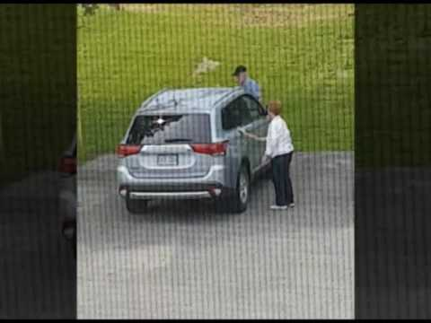 Old woman and man cleaning car with swiffer