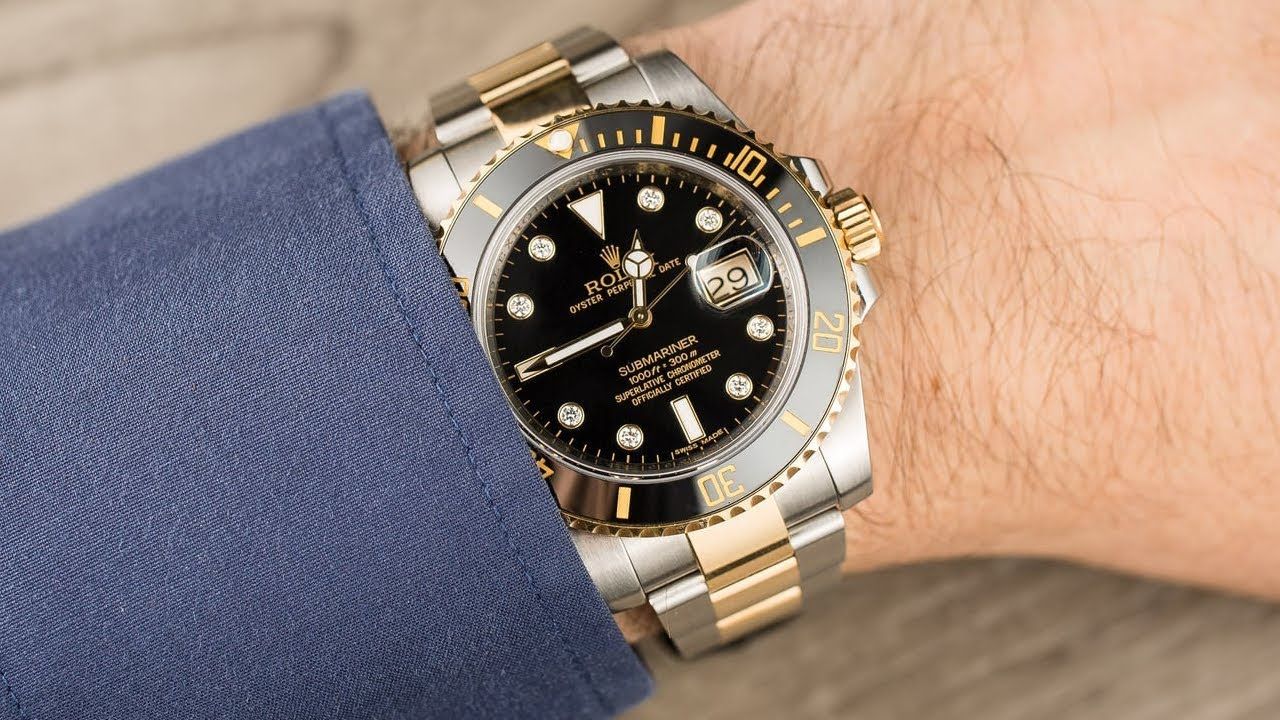 Rolex Submariner Date 116613LN Black diamond dial 40 mm steel and yellow  gold luxury watch on wrist