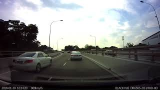 Lornie Road mercedes E250 doing an overtaking on a continuous white line along