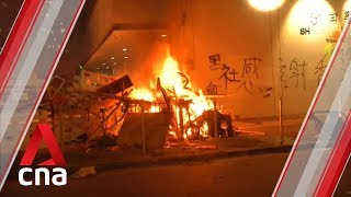 Hong Kong protesters set fire to items outside Sha Tin police station