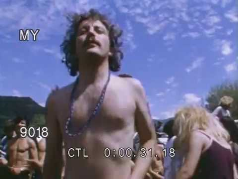 1970s Hippies Dancing and Playing Bongos at a Festival Stock Footage