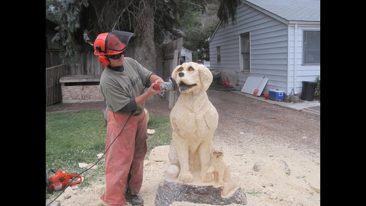 Chainsaw pine tree carving of a dog and cat by