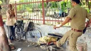 UP cop Pradeep Kumar suspended  for smashing old man's typewriter || Video Viral || NEWS 2015