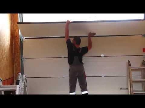 видео: Монтаж гаражных секционных ворот alutech