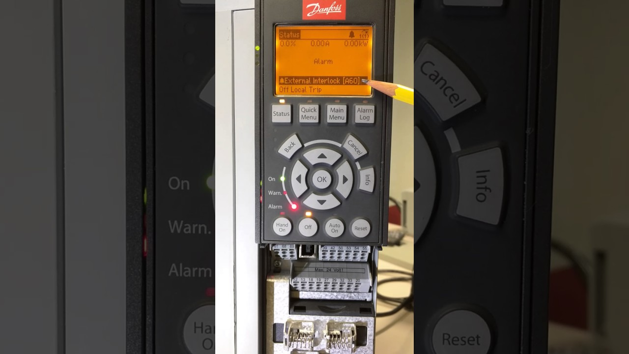 Generating alarms for commissioning on Danfoss VFDs